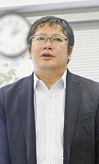 新津研一事務局長