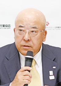 田川博己会長(記者会見にて)